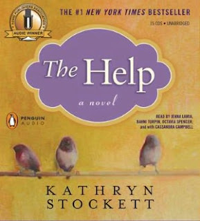 Inside a lavender cloud, it reads The Help, a novel. The rest of the cover is a mustard-colored yellow. Three dusky birds balance on a wire above the author's name.