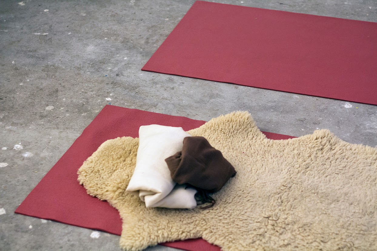 yoga mats and a sheepskin