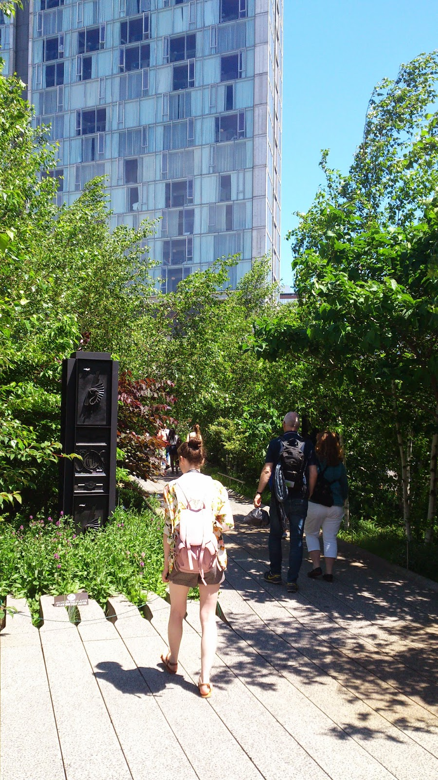 new york city high line trees and nature in city girl tourist in city