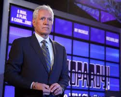 Alex Trebek and Jeopardy! board