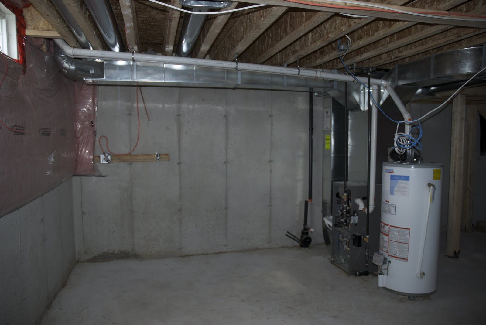 Houseonashoestring unfinished basement decorating - Unfinished basement design ...