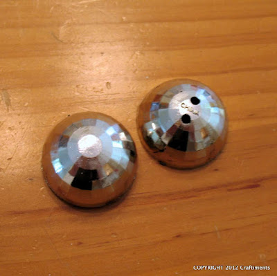 Two halves of disco ball party favors