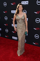 Daphne Zuniga cleavage in a gown on the red carpet
