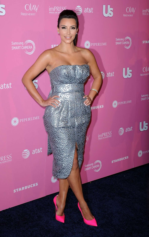 Kim Kardashian  sparkles in a silver dress, 2012 photo from Us Weekly Hot Hollywood Style Party 2012