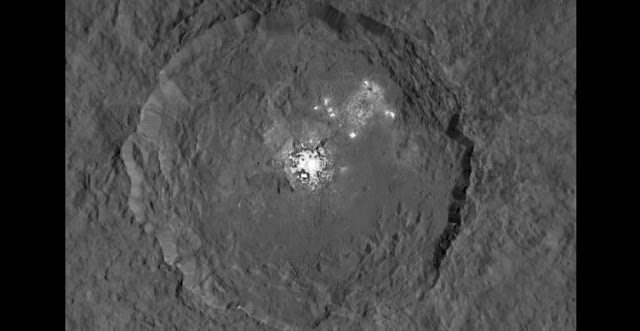 One of the most intriguing features on Ceres, Occator crater, is home to the brightest areas on Ceres. Image credit: NASA/JPL-Caltech/UCLA/MPS/DLR/IDA