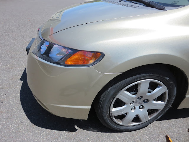 2008 Honda Civic with new fender, bumper and headlamp from Almost Everything Auto Body