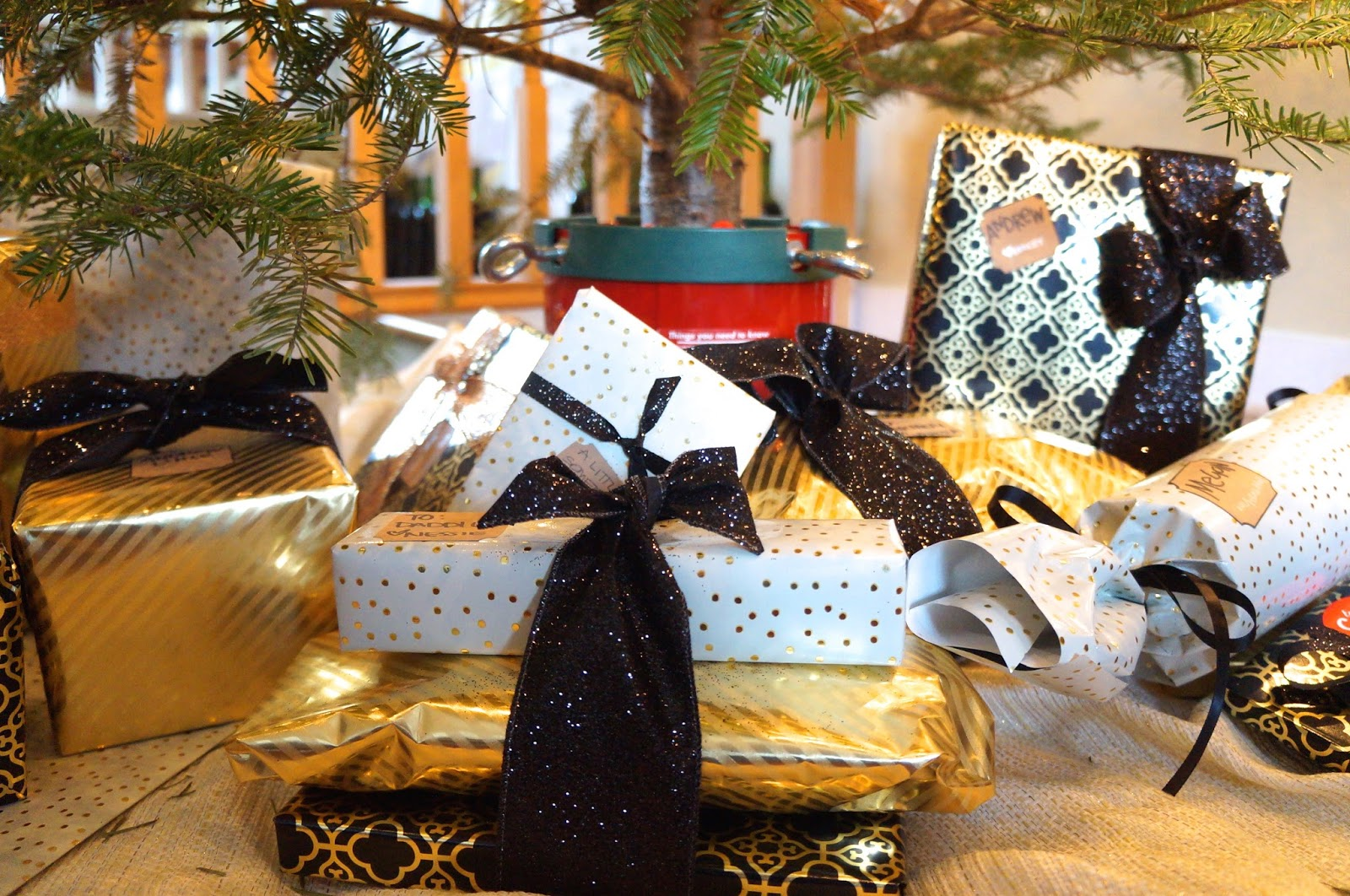 gold black and white wrapped presents