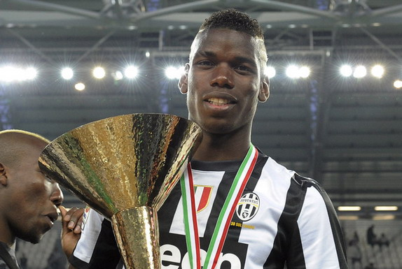 Juventus player Paul Pogba celebrates with the Serie A trophy after winning the Scudetto