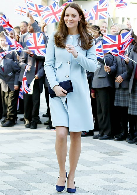 Kate Middleton shows off baby bump in a blue cashmere coat in Kensington