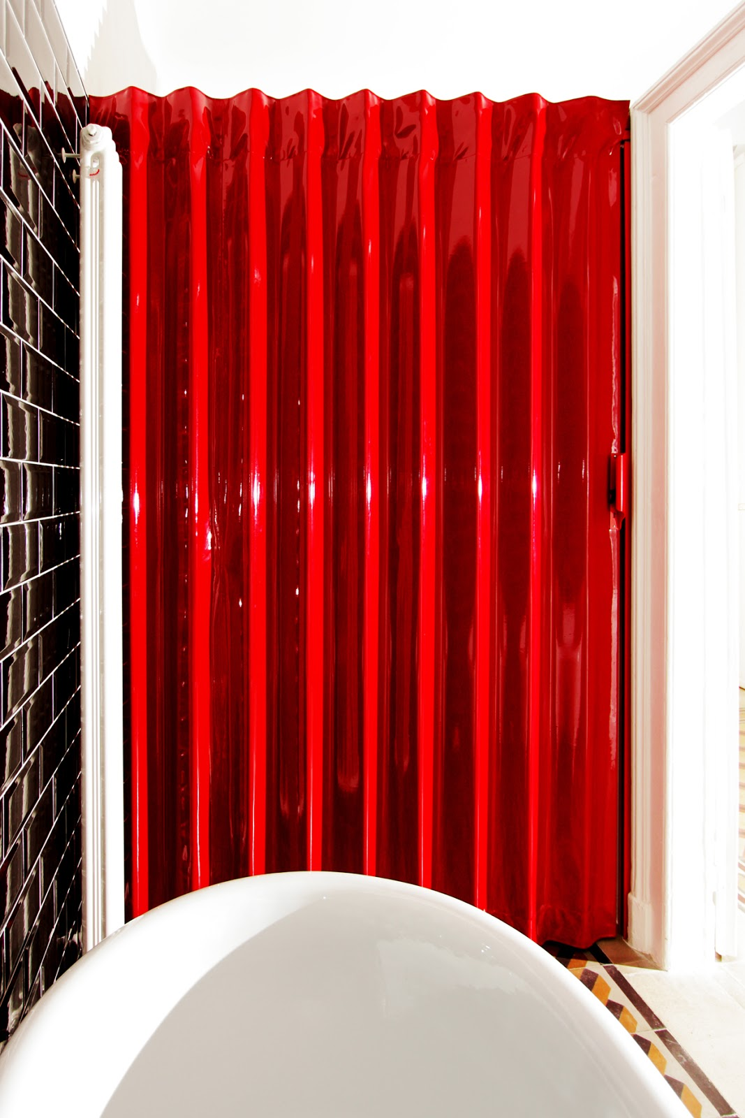 Accordion doors glossy red folding door by architect for Accordion doors