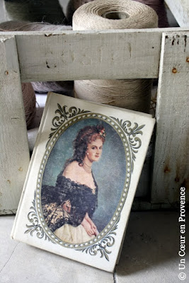 An antique book whose cover is decorated with a portrait of the countess of Castiglione, mistress of Napoleon IIIe