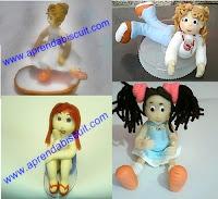 Várias bonequinhas em biscuit