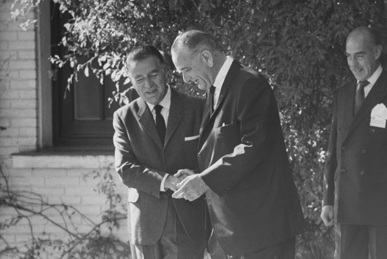Pres. Lyndon B. Johnson (3L) talking with Fernando Belaunde (2L) at Summit conference.