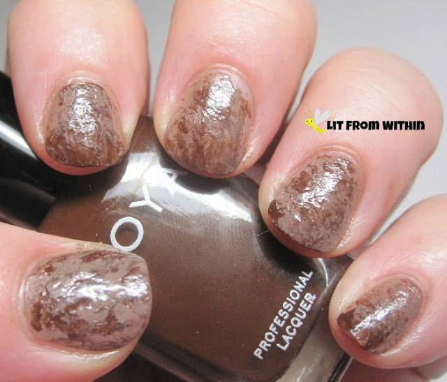 Saran Wrap mani!  I actually did this with a piece of grocery bag and a bit of Zoya Louise