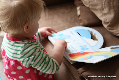 Holly Reading Her Little Learners Peek-a-Boo Rainbow Book