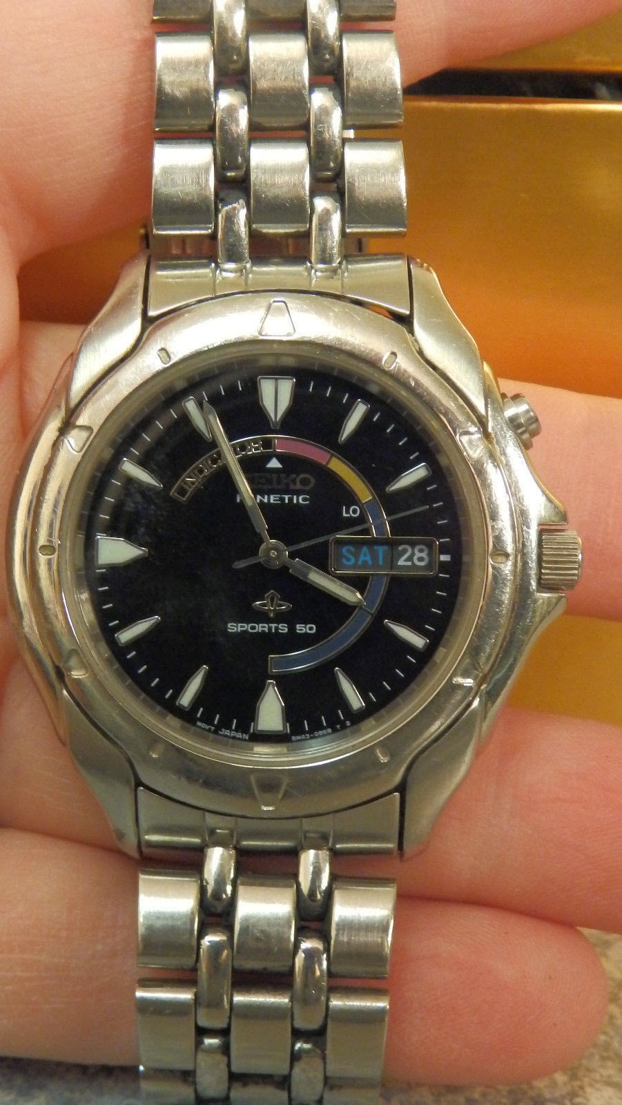 http://www.ebay.com/itm/mens-seiko-watch-kinetic-sports-50-Silver-tone-band-with-black-face-/321690501145?pt=LH_DefaultDomain_0&hash=item4ae63f8019