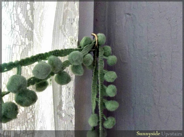 Use a cup hook to anchor a curtain tie back