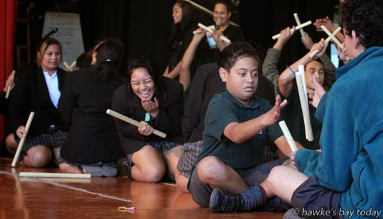 Second right: Devaan Stuart-Gray, William Colenso College, plays Tititorea, a stick game - Matariki Festival, performances and games organised by students at William Colenso College, Napier. photograph