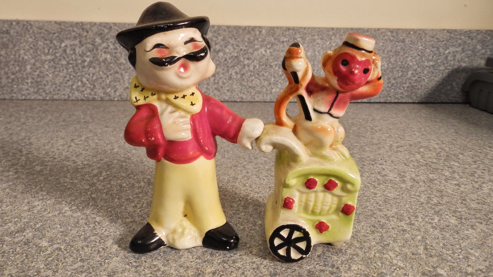 http://www.ebay.com/itm/vintage-salt-pepper-shaker-Organ-Grinder-and-Monkey-/321689588053?pt=LH_DefaultDomain_0&hash=item4ae6319155