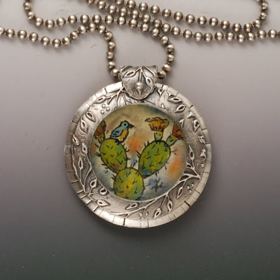painted vitreous enamel on glass set in silver pendant by Vickie Hallmark