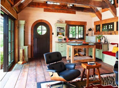 remodel, one room house, Tiny cottage, Colorado cottage, stone cottage, remodel, one room house, curved front door, green cabinets, rolling island, wood trusses, farmhouse sink, Eames chair ARCHITECTURE & INTERIOR DESIGN by TKP Architects PHOTO by Emily Minton Redfield MORE INFO at: www.mountainlivin...