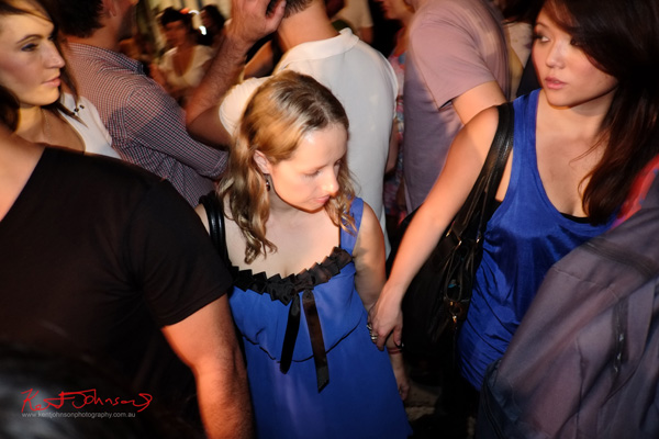 Two blue dresses, friends in the crowd, Art Month Sydney art party Darlinghurst Sydney 2013