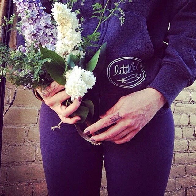 "@larch_and_lager in her little owl ""three sisters"" hoodie holding a beautiful bouquet. Via instagram."