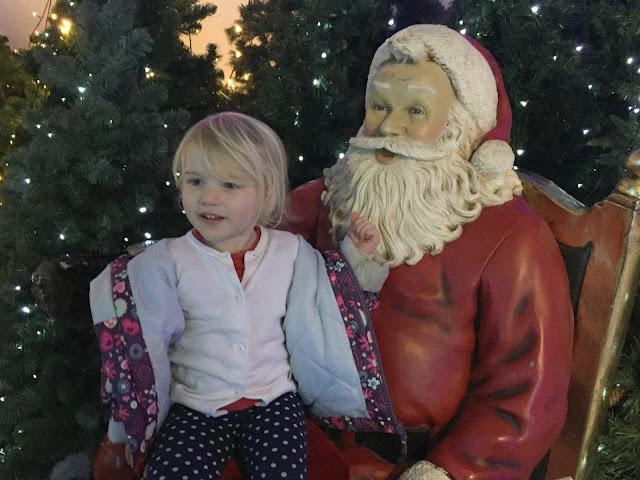 Tin Box Tot with a model Santa