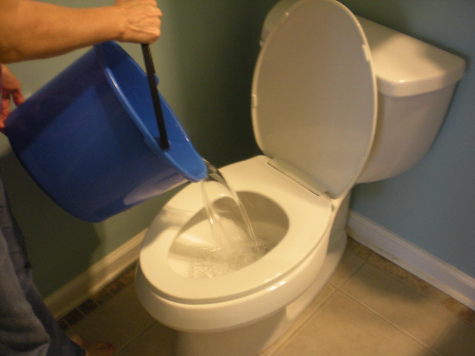 Flushing A Toilet Using Bucket