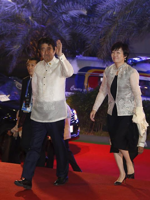 "Japan's Prime Minister Shinzo Abe, wearing the traditional Philippine ""barong"", and wife Akie"