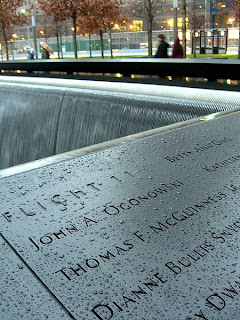 The names of John Ogonowski, Thomas F. McGuinness, Betty Ong, and other 911 victims from American Airlines Flight 11