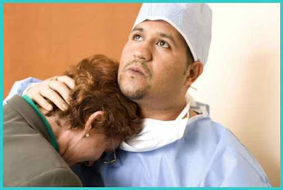Doctor Consoling Patient Relative