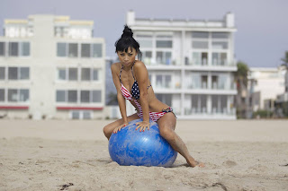 Bai Ling  hot pose sitting on a blue yoga ball