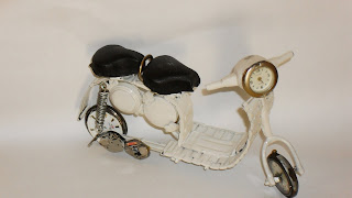 Artesanato com peças de relógios
