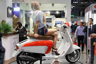 sexy girls on scooter motor