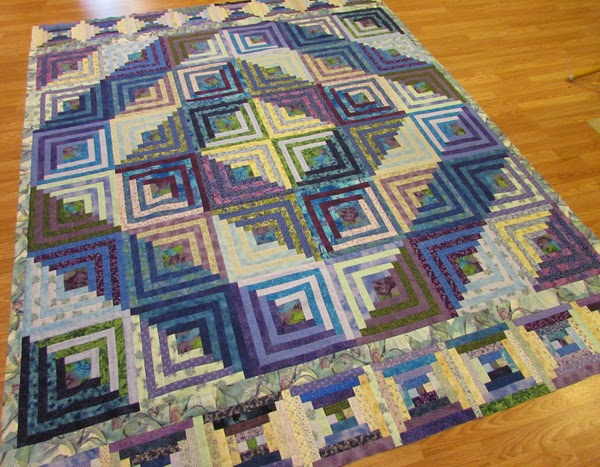 scrappy log cabin quilt top
