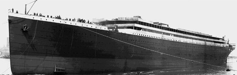 Documentary Photographs of Titanic: Titanic is Towed to Her Outfitting Berth