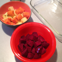 image shows one bowl with chopped rutabagas and carrots, the other bowl with chopped beets