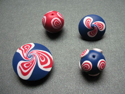 Polymer clay beads decorated with a swirl cane