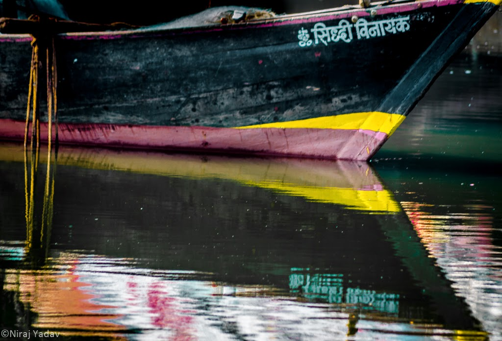 konkan bike trip, reflection of boat in water