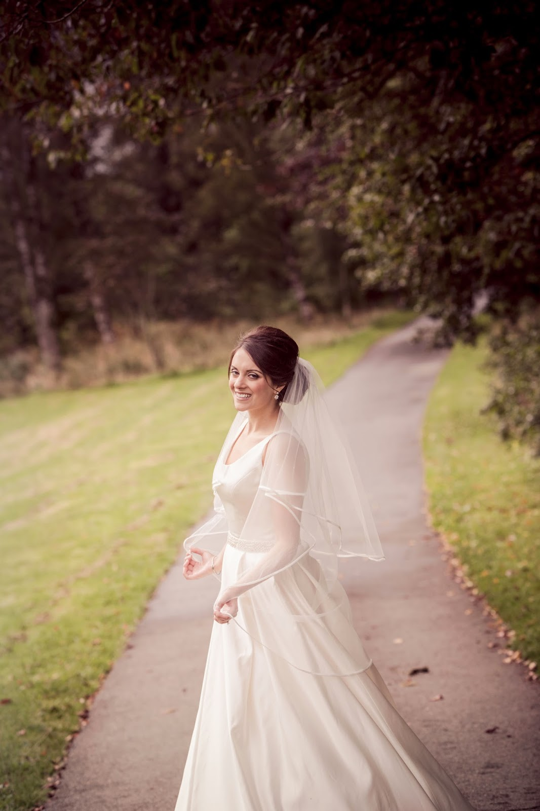 beautiful shot of the bride in her satin gown and veil