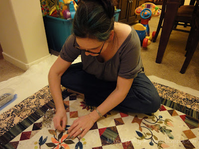 me sitting down and basting my Hop to It quilt... go me!