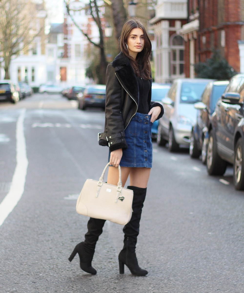 peexo fashion blogger wearing black aviator jacket and knee high boots