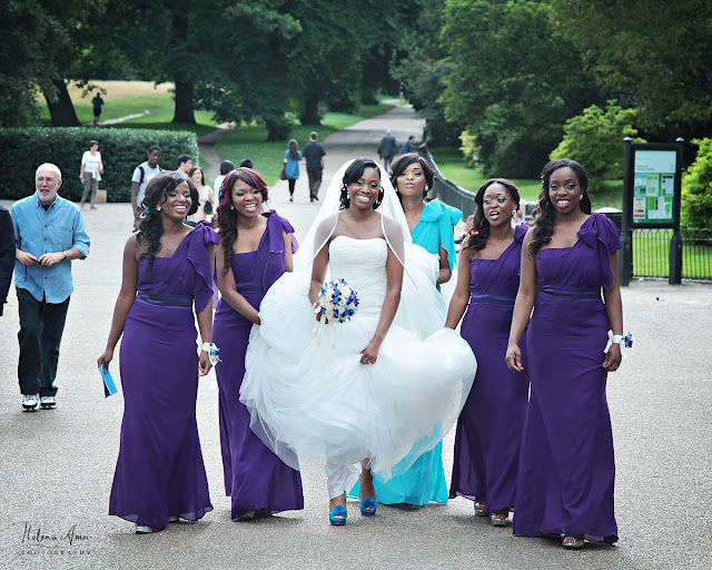 bride and bridesmaids helping her with the dress at Hyde Park
