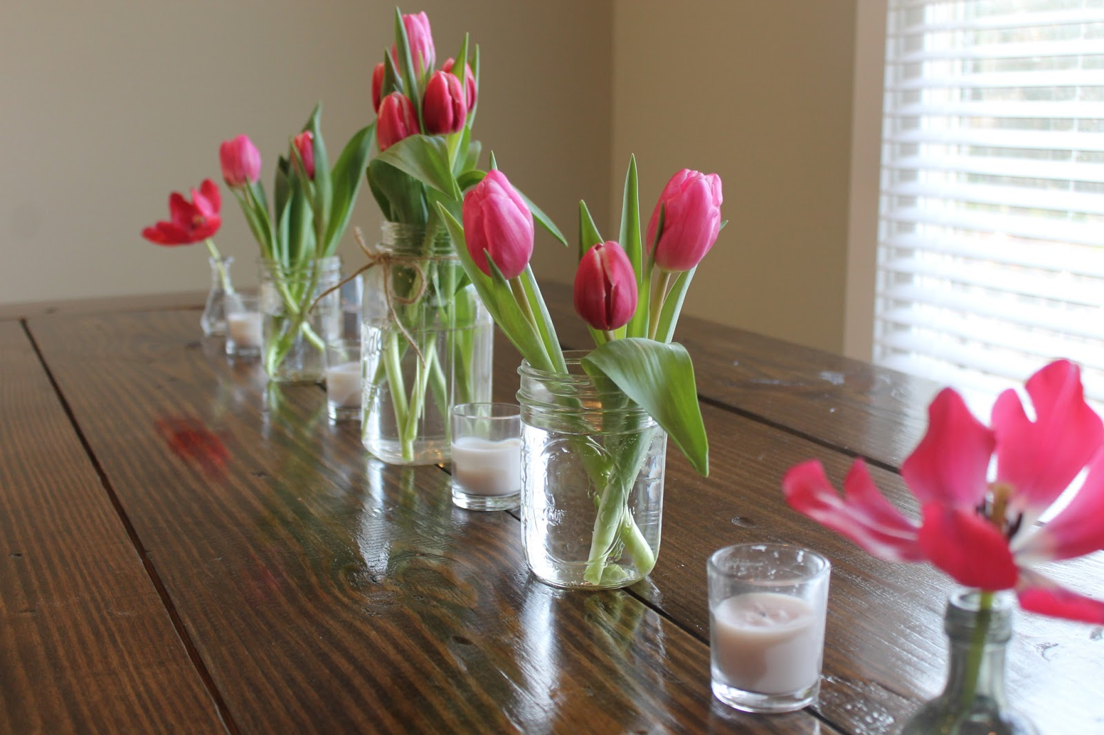 Get your tulips to tango part ii carolina charm i spread my bouquets all throughout the house until i can find the perfect dining table centerpiece i am filling it up with vases of hot pink tulips floridaeventfo Gallery