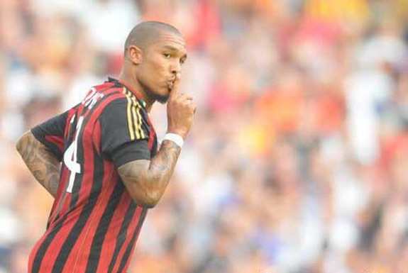 AC Milan player Nigel de Jong celebrates after scoring his side's second goal against Valencia