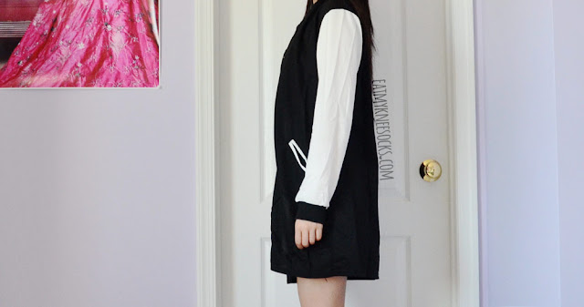 Side view of Dresslink's sporty-casual longline baseball jacket with colorblocked white-and-black detailing.