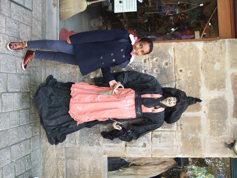 My daughter standing next to the witch were there is a haunting shop behind her in St cere.