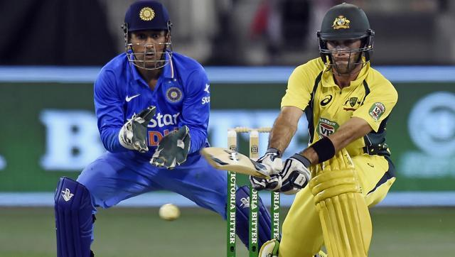 Australia's Glenn Maxwell hits a reverse sweep watched by India's MS Dhoni during their one day international cricket match in Melbourne. (AP)