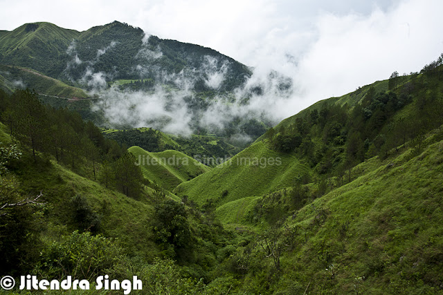 Chakrata is a beautiful & calm hill station in Uttrakhand state of India. Jitendra love such peaceful places to explore and hill stations in this category ranks on top for him. Let's check out this PHOTO JOURNEY through Jitendra's Travelling-Camera.Chakrata is getting more popular as a hill station and people love spending some quality time around these beautiful/fresh hills. Chakrata is basically a cantonment area in Dehradoon district of Uttranchal which quite clean and peaceful. Chakrata town of Uttrakhand can be reached from Dehradun via Mussoorie or Vikasnagar. Both routes pass through beautiful mountainous road. Travelling in the monsoon can be more adventurous as the area sees frequent land-slides, which usually block the roads for longer period of time or at least significantly impact the travel plans.Yamuna valley has amazing panoramic view of the surroundings from the hillock. Chakrata is basically developed by the British rulers and was a summer retreat for the high executives of English East India Company, like other places in Northern India - Shimla, Dalhousie, Masoorie etc. Presently Chakrata encloses military cantonment and the access is restricted here for civilian travelers.The area has an lot of conifers, red rhododendrons and oaks. One of the key attractions near Chakrata is the waterfall named 'Tiger Fall'.Overall local folks are quite helpful and simple. Talking to anyone on the streets around Chakrata is a wonderful experience, where people welcome with broad smiles on their faces. All this makes the travel experience more enjoyable with happy faces all around, who are quite welcoming and helping in natureChakrata is an access-restricted military cantonment and foreigners face severe restrictions in visiting while around this region. It is the permanent garrison of the secretive and elite Special Frontier Force, also known as Establishment 2-2, the only ethnic Tibetan unit of the Indian Army, which was raised after the Indo-China War of 1962.A 